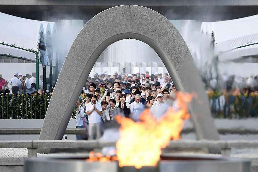 People praying at Hiroshima's Memorial Cenotaph yesterday for the victims of the 1945 atomic bombing. Japan is the only country to have suffered atomic attacks, which claimed 140,000 lives in Hiroshima.