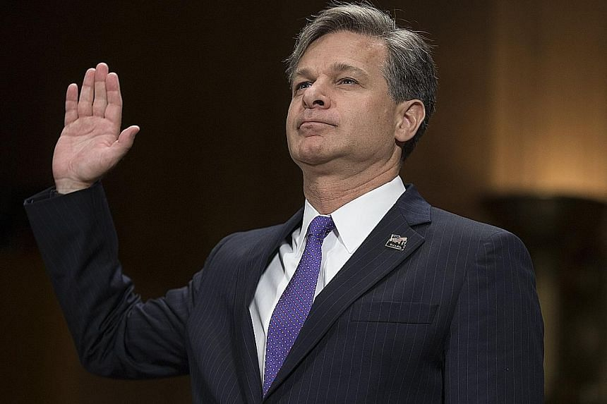 """Mr Christopher Wray said last month that his """"loyalty is to the rule of law""""."""