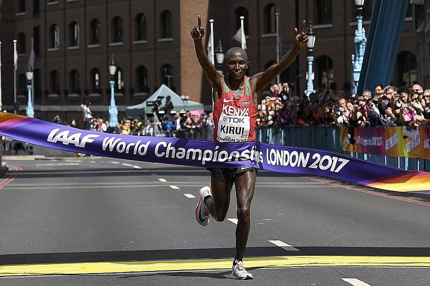 Geoffrey Kirui of Kenya celebrates after winning the marathon at the athletics World Championships in London yesterday. Ethiopia's Tamirat Tola finished second and Tanzania's Alphonce Simbu took the bronze.