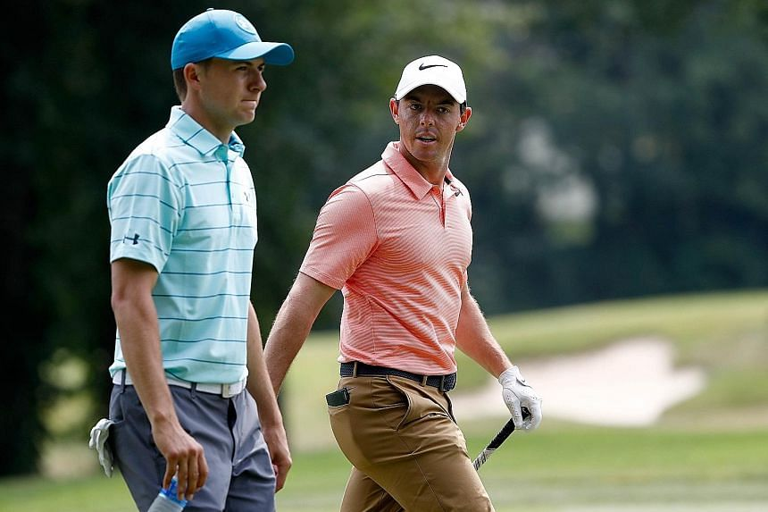 Jordan Spieth (left) and Rory McIlroy during the second round of the Bridgestone Invitational in Akron, Ohio, last Friday. If the American wins the next Major, the PGA Championship, this week, he will beat the Northern Irishman to a career Grand Slam