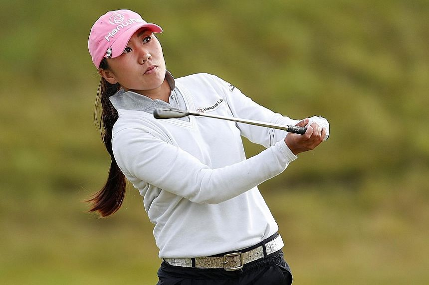 Six birdies lifted South Korean golfer Kim In Kyung (left) to the Women's British Open 54-hole record of 199 on Saturday - one better than Thailand's Ariya Jutanugarn at Woburn 12 months ago. The 29-year-old's faultless third round of six-under 66 ga
