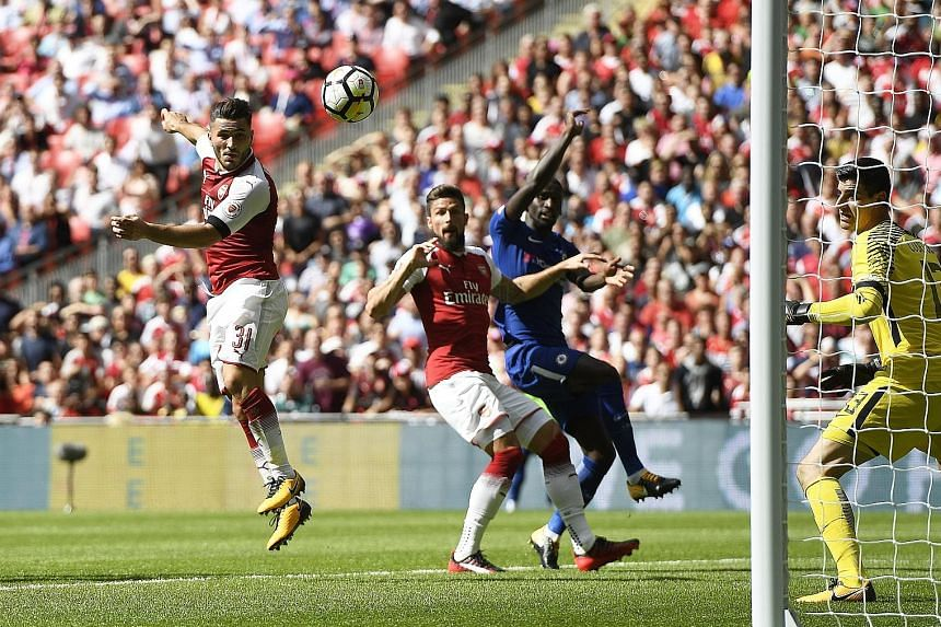 Sead Kolasinac (far left) heads in a late equaliser on his Arsenal debut. The Bosnian defender replaced the injured Per Mertesacker in the first half.