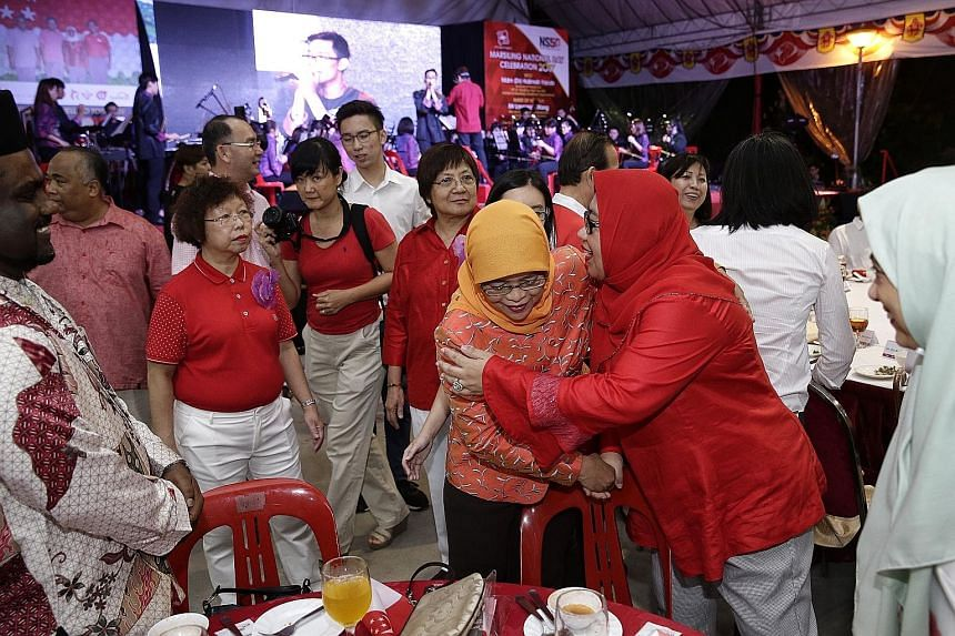 Madam Halimah Yacob, an MP for Marsiling-Yew Tee GRC, getting a hug from teacher and resident Rahidah Mohd Noor, 51, at the Marsiling National Day dinner celebration last night.