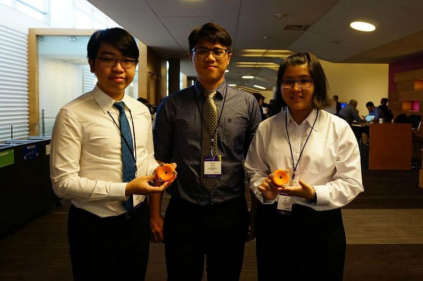 Students from Nanyang Polytechnic (left to right) Sean Wong, Chew Zhi Qi and Lian Min with their invention , the Smart StethoScope, at the Microsoft Imagine Cup 2017 finals.