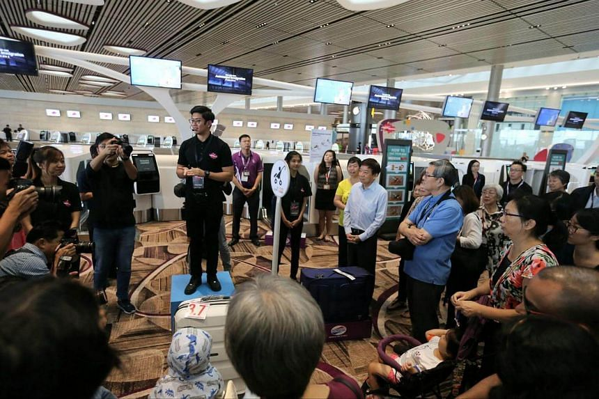 Coordinating Minister for Infrastructure and Minister for Transport Khaw Boon Wan (right, in light blue) at the open house for Changi Airport's Terminal 4 on Monday (Aug 7).