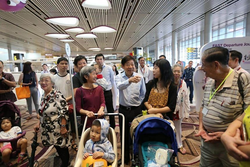Coordinating Minister for Infrastructure and Minister for Transport Khaw Boon Wan (centre) at the open house for Changi Airport's Terminal 4 on Monday (Aug 7).