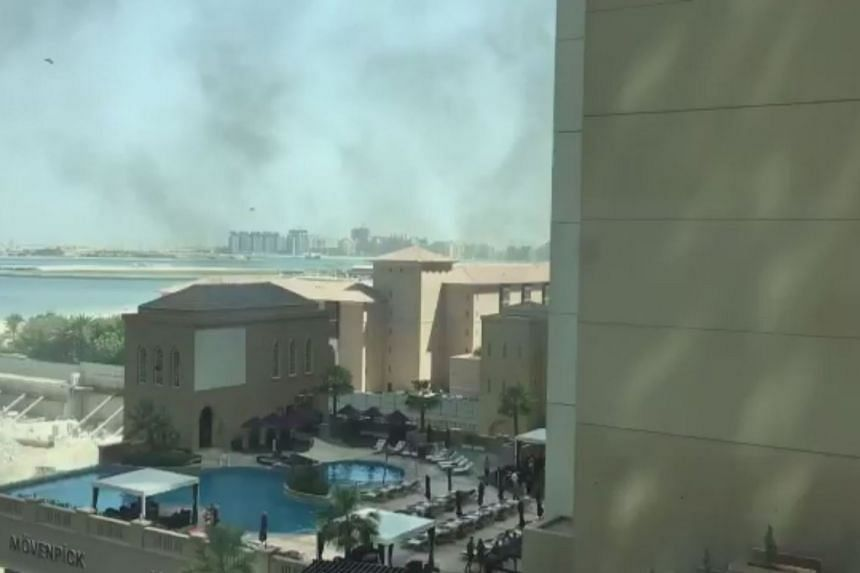 Smoke is seen coming from the Movenpick Hotel in Dubai, after a small fire broke out on Aug 7, 2017.