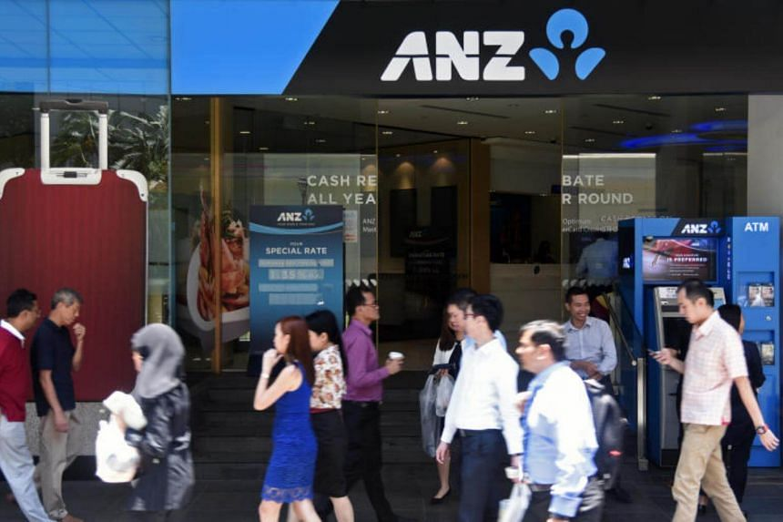 People walking at the entrance of ANZ Bank at Raffles Place.