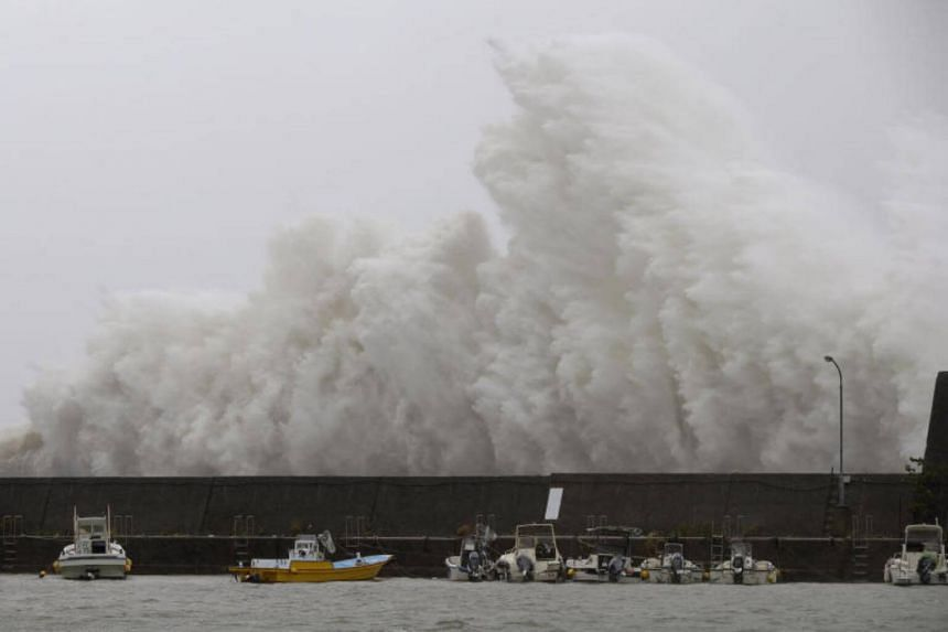 A big wave caused by Typhoon Noru crashes on a breakwater in Aki, Kochi Prefecture, Japan on Aug 7, 2017.