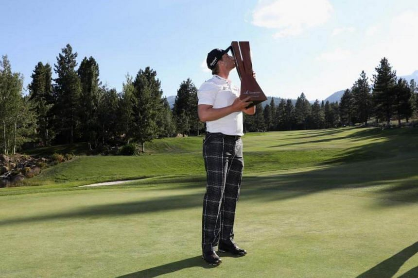 Chris Stroud poses with the trophy after winning the final round of the Barracuda Championship on Aug 6, 2017 in Reno, Nevada.