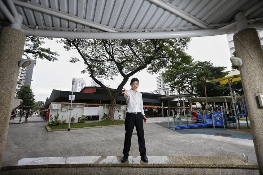 Dr Sin Yong at the pavilion in front of Ghim Moh Market, where he performs magic tricks for residents, on July 20, 2017.