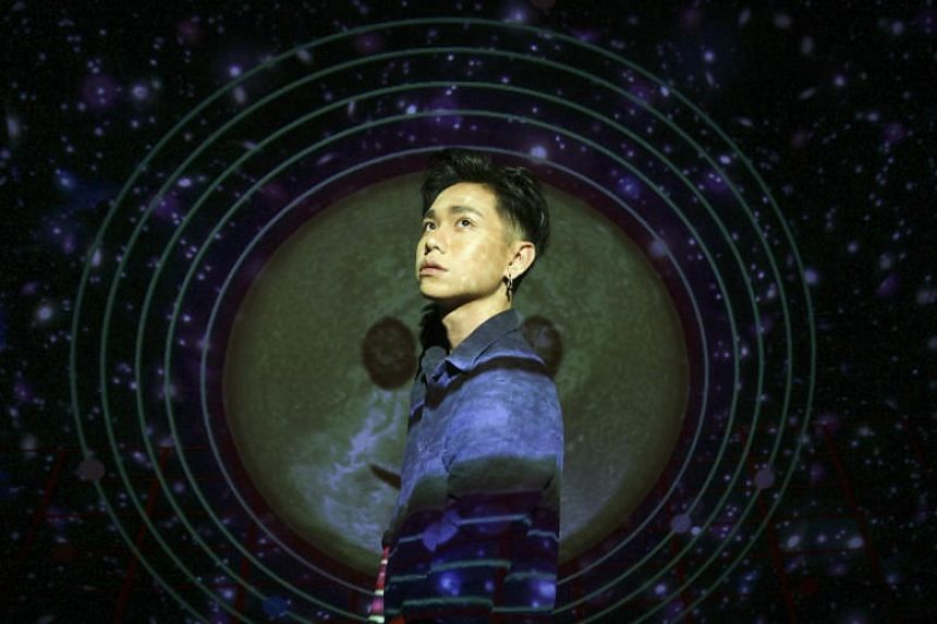 Howie Kim photographed with his projection mapping installation, The World Revolves Around You.