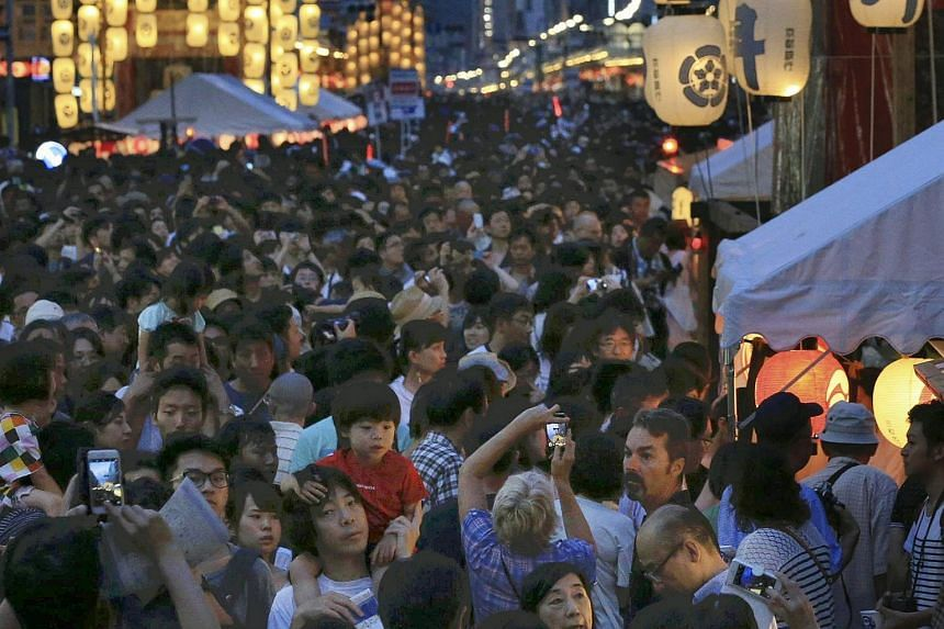 People gathering in Kyoto during the month-long Gion festival, on July 16, 2017.