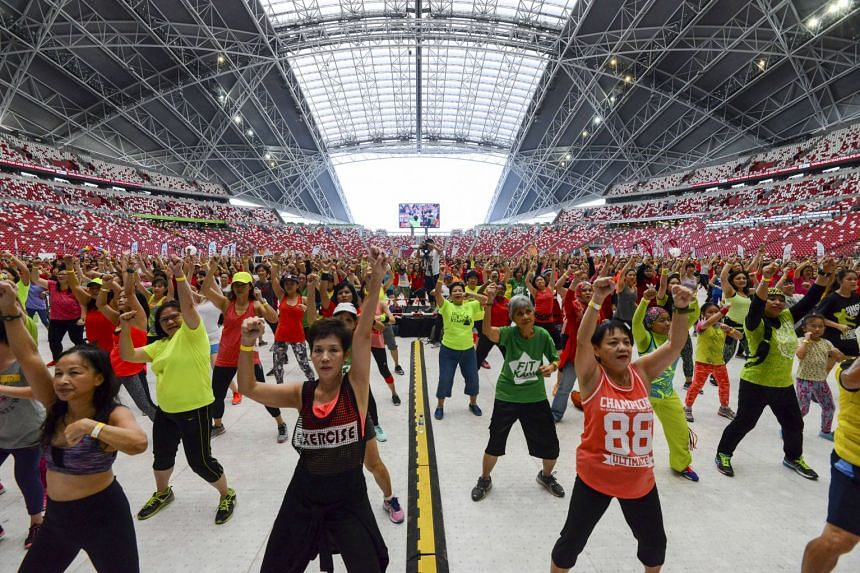 Participants enjoying themselves at a mass Zumba event held at the Singapore Sports Hub.