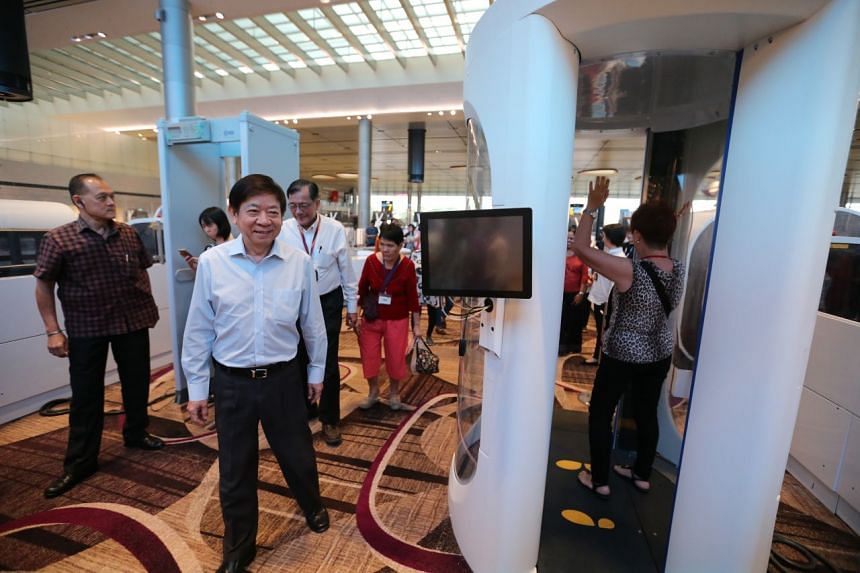 Coordinating Minister for Infrastructure and Minister for Transport Khaw Boon Wan (front) at the open house for Changi Airport's Terminal 4 on Monday (Aug 7).
