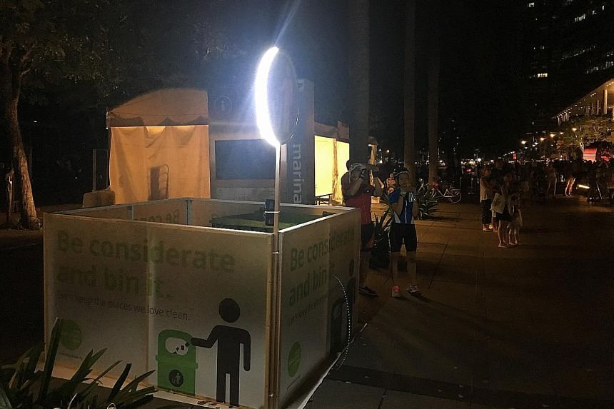 """""""Bins"""" such as this one at the Promontory - essentially areas fenced up with screens to accommodate large amounts of rubbish - will be lit up with LED lights so spectators can locate them easily in the dark."""