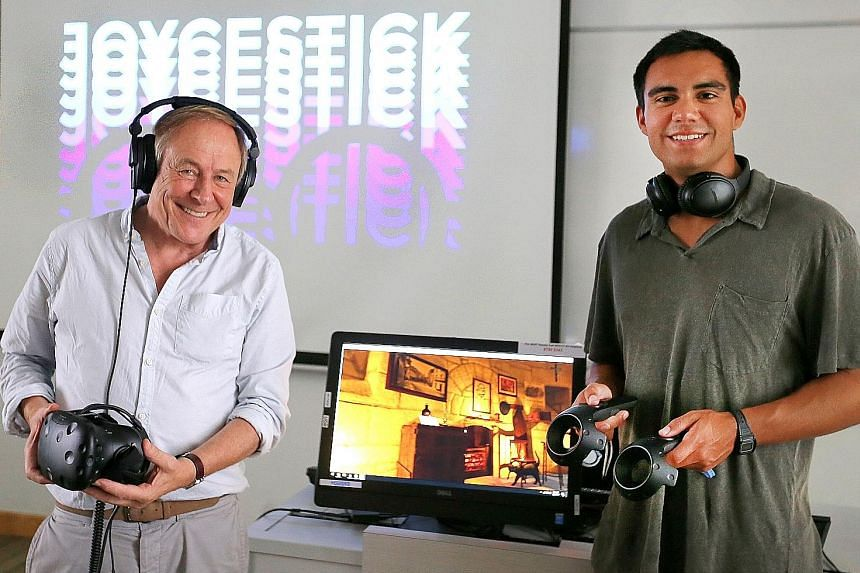 Professor Joseph Nugent of Boston College (left) and Mr Ryan Reede, a computer science major at the university, demonstrating Joycestick, a 3D virtual reality game that takes one inside Irish writer James Joyce'snovel Ulysses.