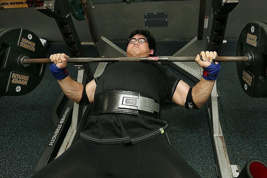 Medical officer Benjamin Soh doing a 190kg bench press, one of the three types of lifts in powerlifting. Strength training helps to improve one's bone health, prevent falls and even reduce the risk of diabetes.