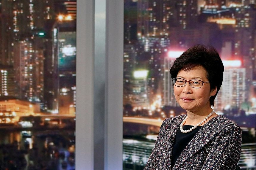 During her China trip, Mrs Carrie Lam said, she would also be discussing plans to promote the development of the Guangdong- Hong Kong- Macau Greater Bay Area, an economic development triangle.