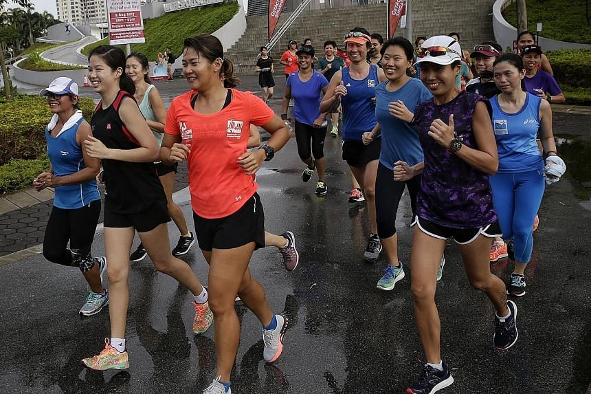 Rockrunners founder Cheryl Tay (in orange) leading the pack in a 3km run during the Women's Squad Activation launch at the Singapore Sports Hub on Sunday.