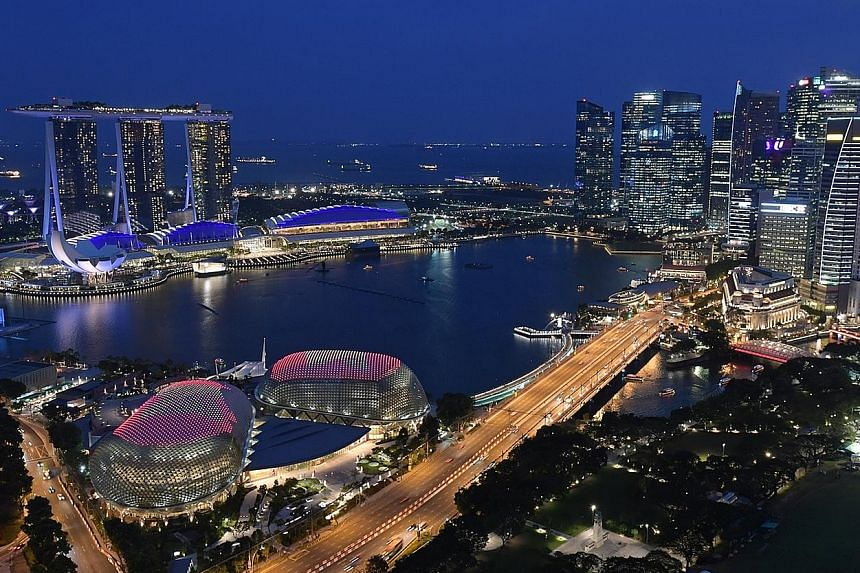 Singapore prepared to celebrate Asean's 50th year in style as it lit up the Esplanade last night with the grouping's emblem. The light-up, seen from Swissotel the Stamford, was a preview for the Philippines' Asean Landmark Lighting Initiative, which