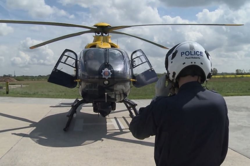 A British police helicopter in a screenshot from YouTube.