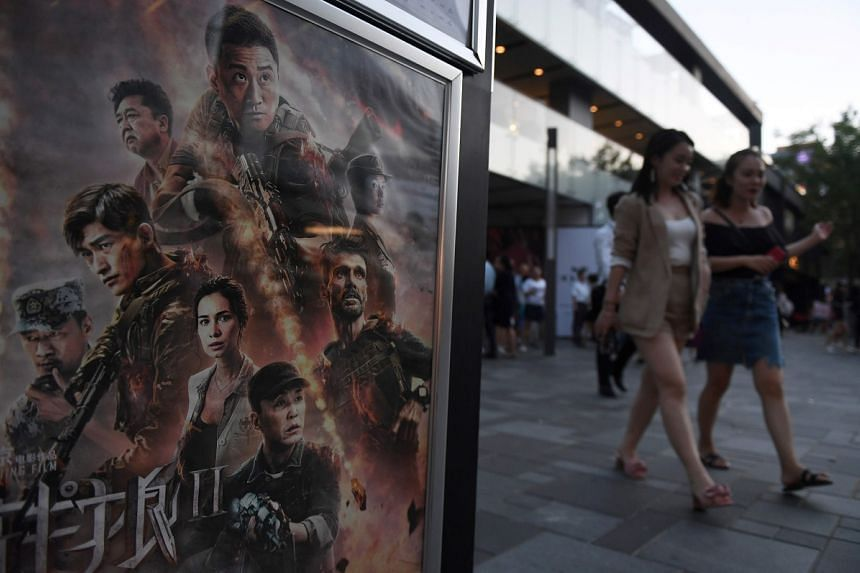 A Wolf Warrior 2 poster in Beijing. The Chinese action film depicts the country's soldiers saving war-ravaged Africans from Western baddies.
