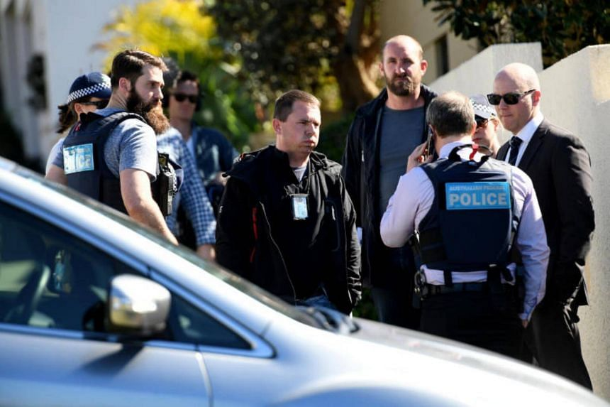 Police stand outside the home of John Ibrahim during a police operation in Sydney, Australia on Aug 8, 2017.