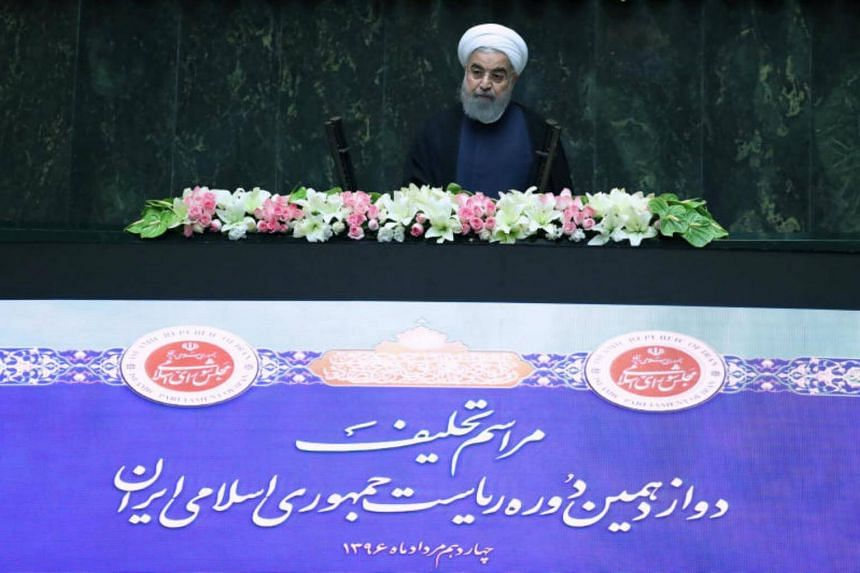 ranian president Hassan Rouhani attends his swearing-in ceremony for a further term, at the parliament in Tehran, Iran, on Aug 5, 2017.