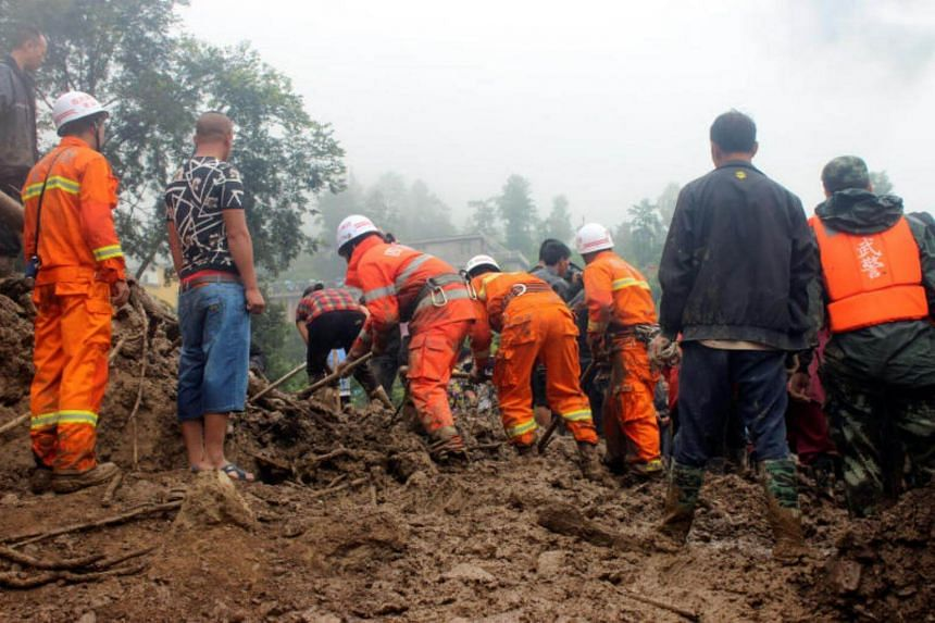 Rescue workers search for survivors at the site of a landslide that occurred in Gengdi village, Puge county, Sichuan province, China on Aug 8, 2017.