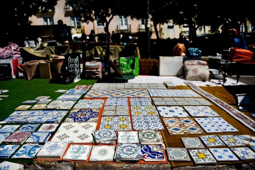 """Several tiles are put up for sale at the """"Feira da Ladra"""" market in Lisbon on July 1, 2017."""