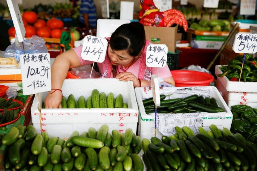 """A vendor at a fresh food market in Beijing. More Chinese are viewing food safety as a """"very big problem""""."""