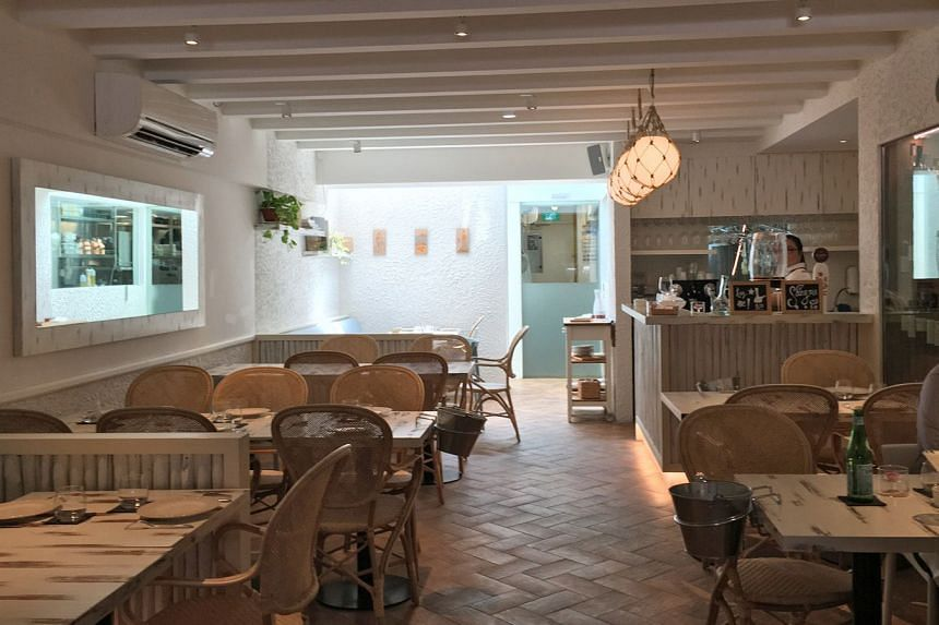 The interior of the restaurant has touches of Spain here and there - textured white walls decorated with ornamental plates, dainty dinner dishes that look like porcelain doilies.