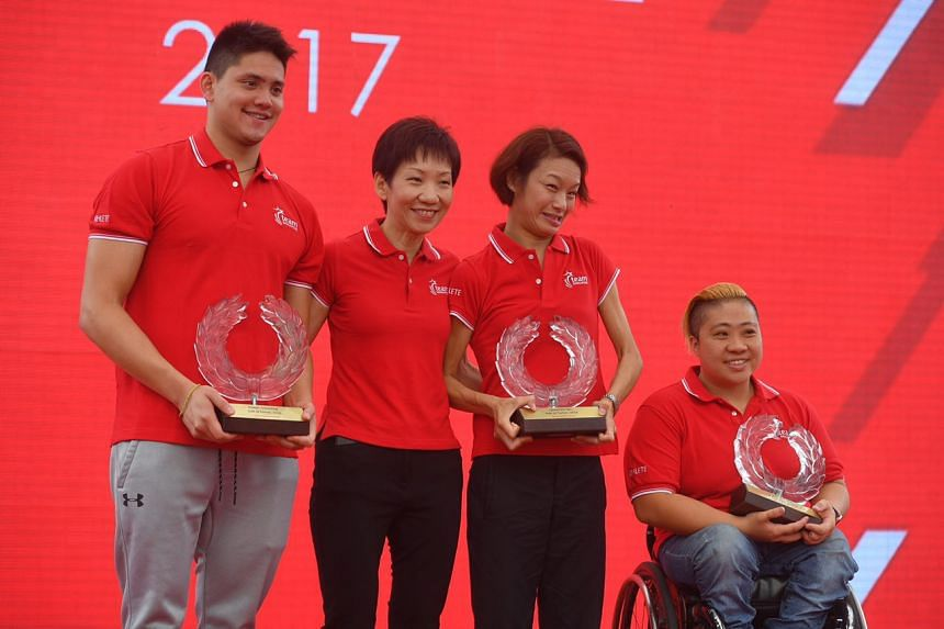 (From left) Joseph Schooling, Minister for Culture, Community and Youth Grace Fu, Paralympic medallists Laurentia Tan and Theresa Goh pose for a photograph after being inducted into the Sport Hall of Fame.