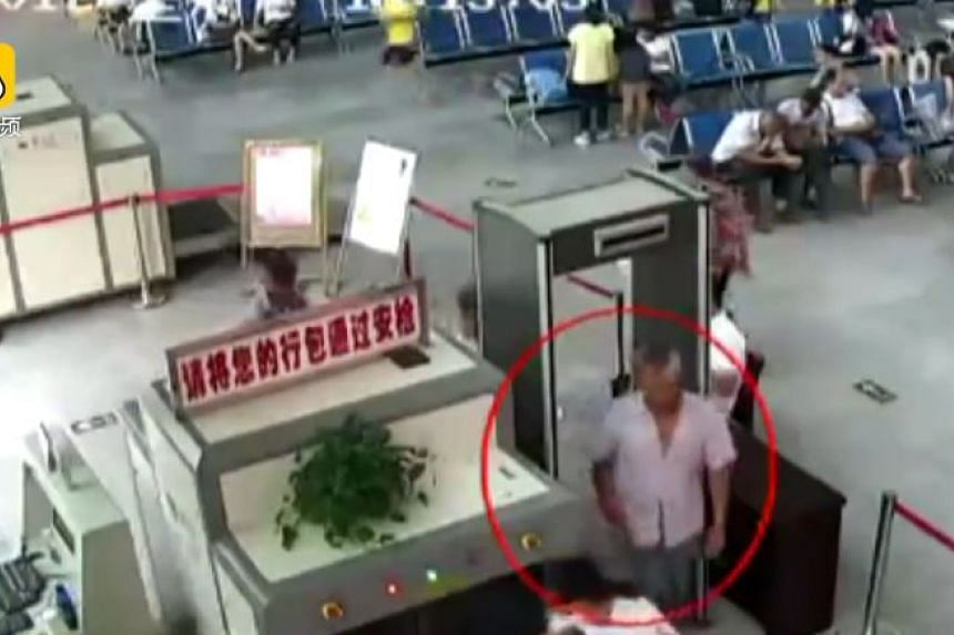 The 50-year-old was caught with the arms when he put his luggage through a security scanner in Duyun in Guizhou province last week