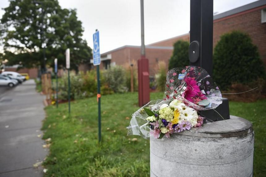 Flowers sit outside the Dar Al Farooq Center Islamic Center, the scene of an explosion in Bloomington, Minnesota on August 5, 2017.