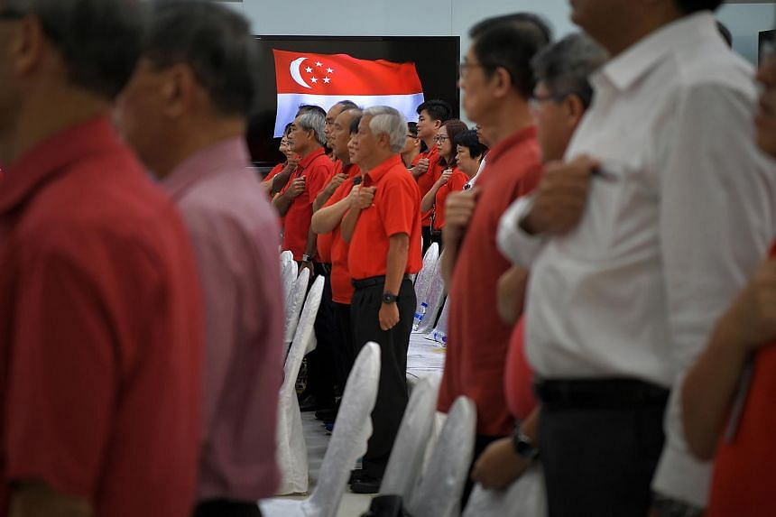 ST Engineering staff reciting the pledge during the National Day Observance ceremony.