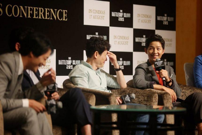 Descendants of the Sun's Song Joong Ki promoting The Battleship Island in Singapore on Aug 8, 2017.