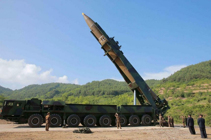 North Korean inter-continental ballistic rocket Hwasong-14 being prepared before a test launch at an undisclosed location in North Korea on July 4, 2017.