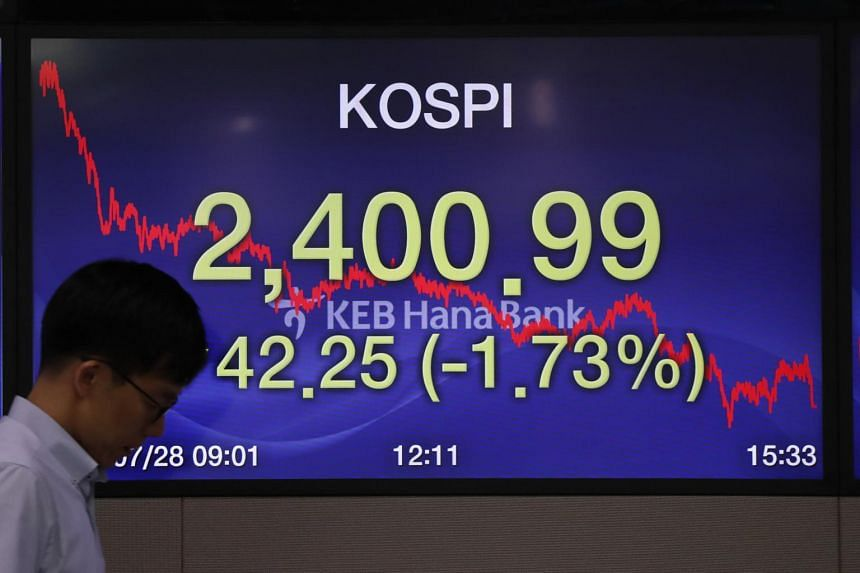 A South Korean dealer works in front of a monitor at the KEB Hana Bank in Seoul.