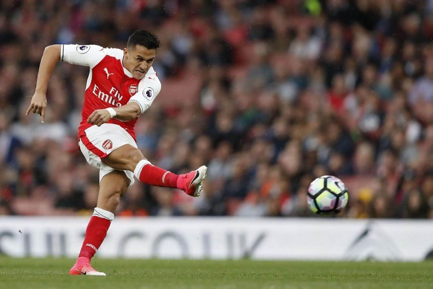 Arsenal's Alexis Sanchez taking a shot at goal during the English Premier League football match between Arsenal and Sunderland at the Emirates Stadium in London, on May 16, 2017.