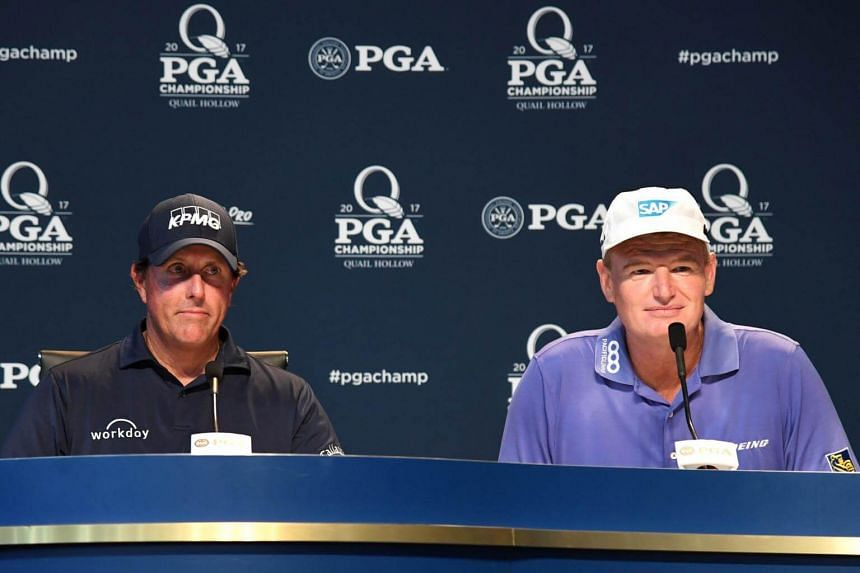 Phil Mickelson (left) and Ernie Els celebrate their 100th major championship during a press conference before the PGA Championship at Quail Hollow Club on Aug 8, 2017, in Charlotte, North Carolina.