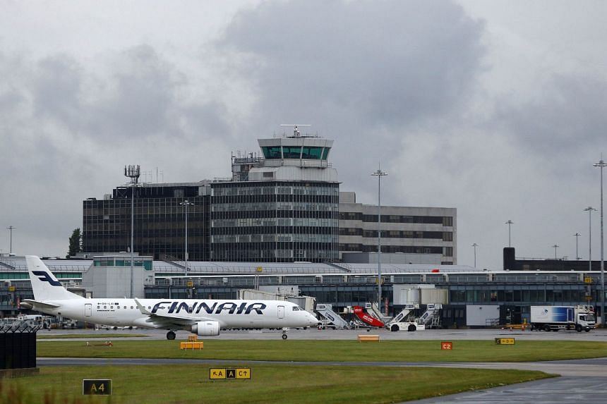 A Finnair aircraft taxis at Manchester Airport.
