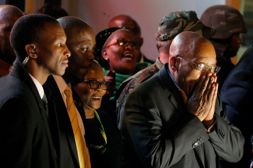 Zuma reacts after he survived a no-confidence motion in parliament in Cape Town, South Africa, Aug 8, 2017.