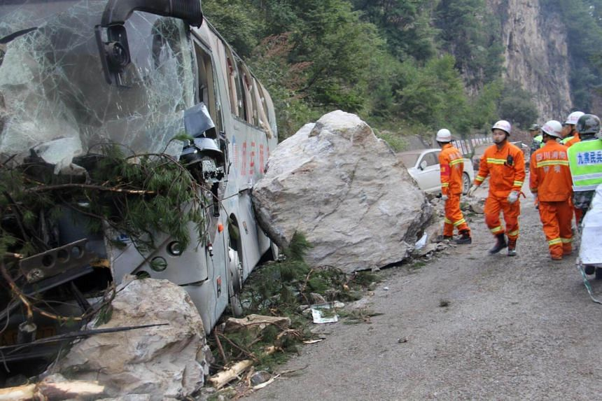 Chinese paramilitary police conducting rescue operations near a wrecked tour bus, in Jiuzhaigou in Sichuan province, on Aug 9, 2017.