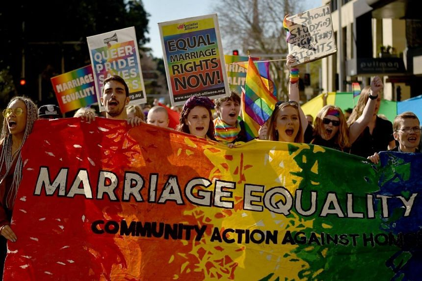 Supporters of marriage equality at a protest march in Sydney on Aug 6, 2017.