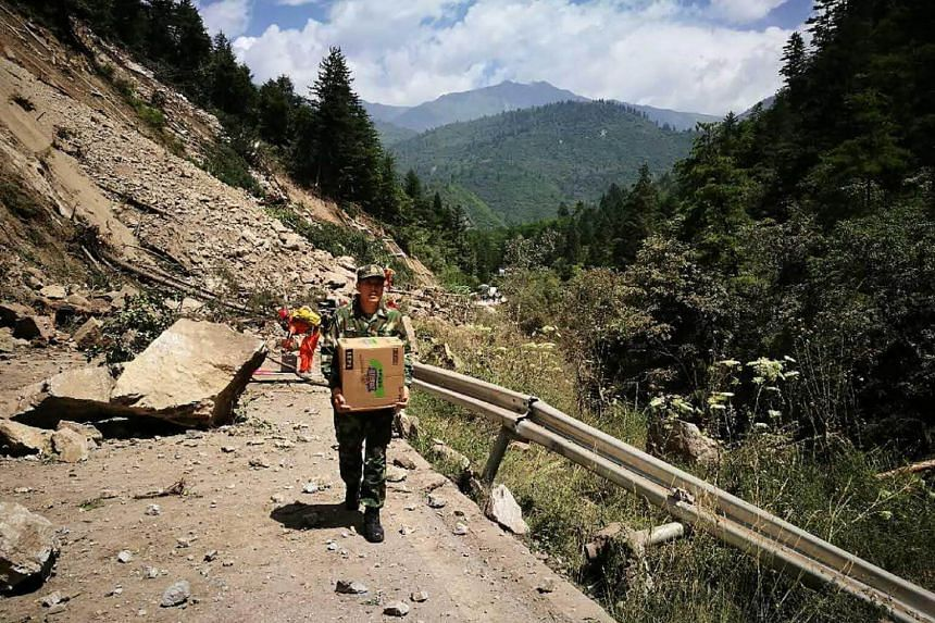 Chinese paramilitary police carrying relief supplies on their way to an earthquake-struck zone in Jiuzhaigou in China's southwestern Sichuan province on Aug 9, 2017.