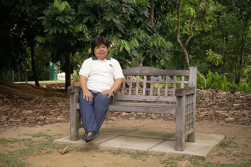 """Mrs Poh-Lim Siew Lan recalls: """"In the beginning we had simple tracks for cycling, jogging. Now we provide more facilities such as fitness corners, benches and playgrounds, if possible."""""""