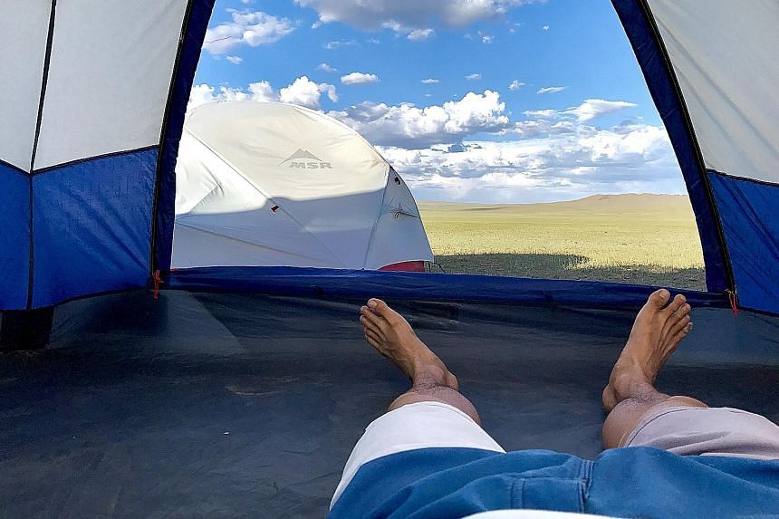 Mr Tay endured 40 deg C heat during his trek through the Gobi Desert, and was forced to continue his journey on bike after losing time when he was laid low by blisters. He and his team pitched tents whenever they could not find people to stay the nig