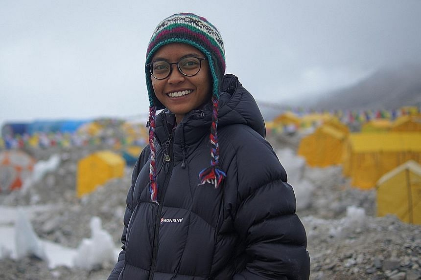 """Ms Nur Yusrina Ya'akob at Everest base camp (left) and on the summit in May. Her desire to climb the world's highest peak stems partly from her love for challenges. """"If I don't put myself in a difficult situation, that's not me. I look for challenges"""